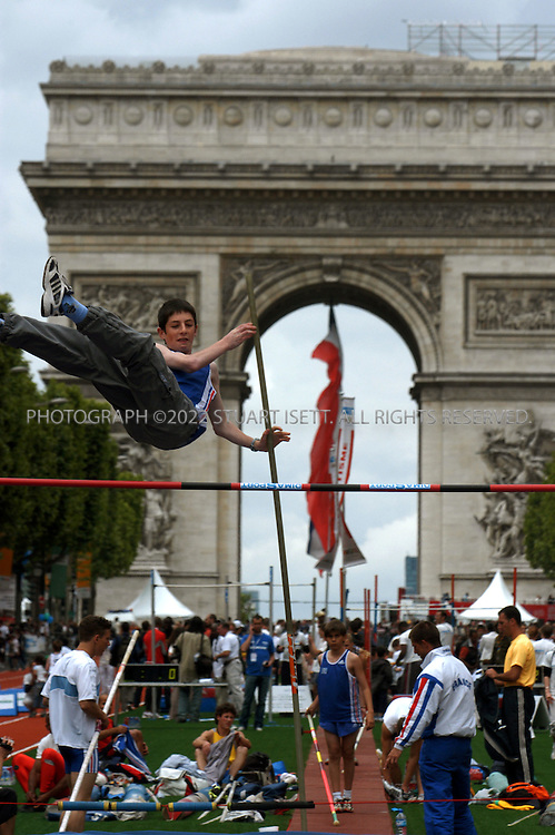 6/5/2005--Paris, France..A French teenager enjoys the pole vault at the 'Fetons l'Amour des Jeux' ('Celebrate the love of the Games') event today on the Champs-Elysées which invited members of the public to participate in numerous Olympic sports on Paris's most famous street. Paris has put in an ambitious bid for the 2012 Olympics, competing with New York, Moscow, London and Madrid and is considered a lead candidate city...The Champs-Elysées was transformed into a symbolic ?Champs  Olympiques? with 28 Olympic disciplines grouped around a gigantic 700 m athletics track running from the Arc de Triomphe to Avenue  George V. Boxing rings, tennis courts, a rowing  pool and a hockey pitch were also set up..Photograph By Stuart Isett.All photographs ©2005 Stuart Isett.All rights reserved.