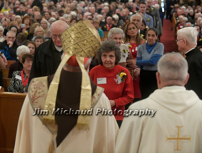 MALDEN MA NOVEMBER25: Cardinal Sean O'Malley looks on as Marie Sullivan of Holy Rosary Parish in Winthrop walks forward to receive the 2018 Cheverus award, one of the 125 recipients, Sunday, November 25, 2018, at the Immaculate Conception Church in Malden. (Herald Photo by Jim Michaud)