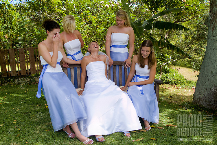 A bride laughing with the women of her wedding party