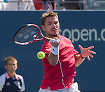 Stanislaus Wawrinka (SUI) battles Andy Murray (GBR) to win the first set (GBR) at the US Open being played at USTA Billie Jean King National Tennis Center in Flushing, NY on September 5, 2013