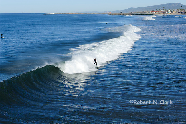 Surfer at Oceanside Pier