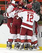 Patrick McNally (Harvard - 8), David Valek (Harvard - 22) and Colin Moore (Harvard - 12) - The Harvard University Crimson defeated the visiting Colgate University Raiders 4-2 on Saturday, November 12, 2011, at Bright Hockey Center in Cambridge, Massachusetts.