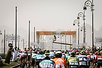The peloton cross underneath the finish gantry during Stage 6 of the 10th Tour of Oman 2019, running 135.5km from Al Mouj Muscat to Matrah Corniche, Oman. 21st February 2019.<br /> Picture: ASO/P. Ballet | Cyclefile<br /> All photos usage must carry mandatory copyright credit (&copy; Cyclefile | ASO/P. Ballet)