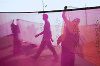 India. Uttar Pradesh state. Allahabad. Maha Kumbh Mela. A man walks by while two Indian Hindu devotee women are drying their sarees after taking a holy dip in Sangam. The Kumbh Mela, believed to be the largest religious gathering is held every 12 years on the banks of the 'Sangam'- the confluence of the holy rivers Ganga, Yamuna and the mythical Saraswati. The Maha (great) Kumbh Mela, which comes after 12 Purna Kumbh Mela, or 144 years, is always held at Allahabad. Uttar Pradesh (abbreviated U.P.) is a state located in northern India. 8.02.13 © 2013 Didier Ruef