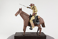 Origami Teddy Roosevelt on horseback folded by Talo Kawasaki. Many designs are included in this model.  Rider figure deigned by David Brill. Horse designed by Saadya Sternberg. Hat designed by Darren Scott. Mustache designed by Kunihiko Kasahara. Saddle and riding gear designed by Talo Kawasaki.