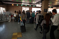 Daytime landscape view of people exiting the subway station at the B?ij?ng Zhàn in D?ngchéng Q? in Beijing.  © LAN