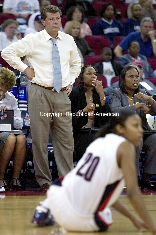 FRESNO, CA. 26 March 2007-032607SV23--UConn Head Coach Gen Auriemma watches a play against LSU during the elite eight round of the NCAA tournament at the Save Mart Center in Fresno, CA. Monday. Alsoi on the bench, Associate head coach Chris Dailey and Assistant Coach Tonya Cardoza.<br /> Steven Valenti Republican-American