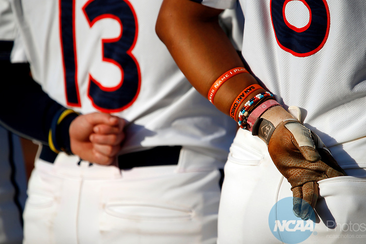 07 JUNE 2016:  Auburn players take a moment of silence before the start the Division I Women's Softball Championship is held at ASA Hall of Fame Stadium in Oklahoma City, OK.  Shane Bevel/NCAA Photos