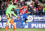 Jose Maria Gimenez de Vargas (r) of Atletico de Madrid battles for the ball with goalkeeper Yoel Rodriguez Oterino of SD Eibar during their Copa del Rey 2016-17 Quarter-final match between Atletico de Madrid and SD Eibar at the Vicente Calderón Stadium on 19 January 2017 in Madrid, Spain. Photo by Diego Gonzalez Souto / Power Sport Images