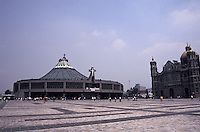 The Basilica de Nuestra de Senora de Guadalupe in Mexico City. Both the tilting, old basilica built aroond 1700 and the new basilica constructed during the 1970's are shown in the photograph.