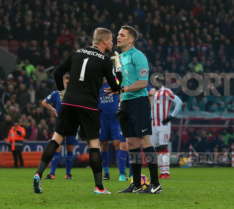 Kasper Schmeichel of Leicester City makes his point to referee Craig Pawson during the English Premier League match at the Bet 365 Stadium, Stoke on Trent. Picture date: December 17th, 2016. Pic Simon Bellis/Sportimage