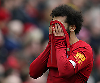 7th March 2020; Anfield, Liverpool, Merseyside, England; English Premier League Football, Liverpool versus AFC Bournemouth; Mohammed Salah of Liverpool wipes his face with his shirt