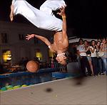 Roni Almeida do Rosario, ballerino brasiliano, ritratto mentre lavora come animatore ad una festa.<br /> Brasilian football player in Balon Mundial, tournament for immigrants living in Piedmont.