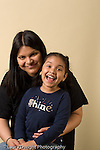 potrait of preschool age girl with her mother laughing vertical age 4 or 5