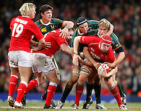 Photo: Richard Lane/Richard Lane Photography..Wales v South Africa. Prince William Cup. 24/11/2007. .Wales' Alun-Wyn Jones sets the ball as South Africa tackle.