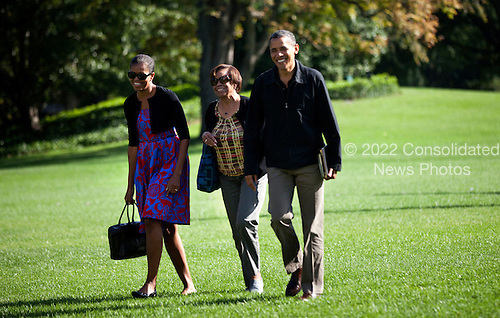 United States President Barack Obama walks with first lady Michelle Obama (L) and his mother-in-law Marian Robinson walk from Marine One to the Residence of the White House October 9, 2011 in Washington, DC.  President Obama was returning from a weekend at Camp David, the presidential retreat near Thurmont, Maryland. .Credit: Brendan Smialowski / Pool via CNP