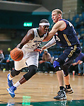 Reno Bighorns' Mo Charlo and Bakersfield Jam's Brian Butch compete during a D-League basketball game in Reno, Nev., on Tuesday, Jan. 14, 2014. The Bighorns won 93-85.<br /> Photo by Cathleen Allison