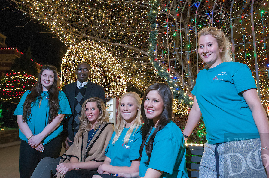 NWA Democrat-Gazette/ANTHONY REYES &bull; @NWATONYR<br /> Godwin-Charles Ogbeide, (second from left) hospitality professor for the University of Arkansas, Lauren Simpson (from left), Ashley Byrd, graduate assistant, Allie Coss, Melanie Grubb, Rosa Weinhold Wednesday, Dec. 9, 2015 on the Fayetteville square. Hospitality students organized the opening ceremony for the Lights of the Ozarks.