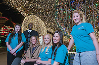 NWA Democrat-Gazette/ANTHONY REYES • @NWATONYR<br /> Godwin-Charles Ogbeide, (second from left) hospitality professor for the University of Arkansas, Lauren Simpson (from left), Ashley Byrd, graduate assistant, Allie Coss, Melanie Grubb, Rosa Weinhold Wednesday, Dec. 9, 2015 on the Fayetteville square. Hospitality students organized the opening ceremony for the Lights of the Ozarks.