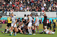 Jamie George of Saracens (hidden) celebrates scoring their first try with team mates during the Aviva Premiership match between Saracens and Bath Rugby at Allianz Park, Hendon, England on 26 March 2017. Photo by Stewart  Wright  / PRiME Media Images.