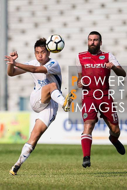 Rui Li of R&F F.C (L) attempts a kick during the week three Premier League match between Kwoon Chung Southern and R&F at Aberdeen Sports Ground on September 16, 2017 in Hong Kong, China. Photo by Marcio Rodrigo Machado / Power Sport Images