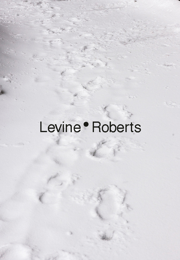 Partially covered footprints in the snow in the Chelsea neighborhood of New York on Tuesday, March 14, 2017. Originally predicted as a blizzard with up to 20 inches of snow the storm has changed its course and only 4 to 6 inches of snow, sleet and rain are expected, accompanied by howling winds of course. (© Richard B. Levine)