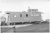 Side view of long caboose #04343 at Alamosa, flying herald.<br /> D&amp;RGW  Alamosa, CO  Taken by Maxwell, John W. - 6/25/1951