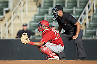 Lakewood BlueClaws catcher Colby Fitch (25) sets a target as home plate umpire Justin Whiddon looks on during the game against the Kannapolis Intimidators at Kannapolis Intimidators Stadium on July 8, 2018 in Kannapolis, North Carolina.  The BlueClaws defeated the Intimidators 4-3.  (Brian Westerholt/Four Seam Images)
