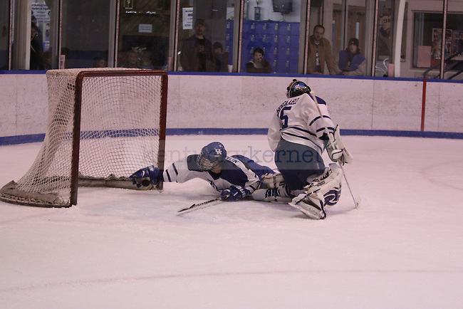 UK's James Morgan plays a little goalie, catching one of the few shots that squeked by goalie Jim Borgaard against Lindenwood University at Lexington Ice Center on Saturday, Jan. 16, 2010. Photo by Scott Hannigan | Staff