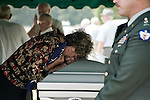 August 26, 2007. Kinston, NC.. A funeral for  Spc. Steven R. Jewell was held at the Pine Lawn Memorial Park in Kinston, NC. Spc. Jewell was killed in a helicopter crash near the Iraqi city of Fallujah on August 14, 2007.. Cindy Wisener, Spc. Jewell's mother, cries over the coffin of her son.