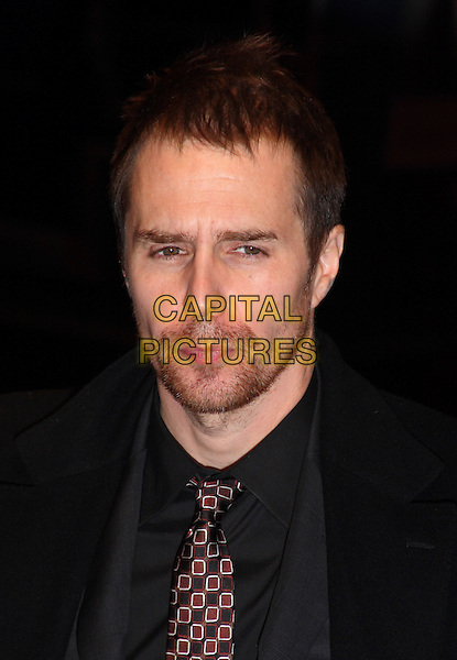 "SAM ROCKWELL .Attending the 54th BFI London Film Festival screening of ""Conviction"" at Vue cinema, Leicester Square, London, England, UK, October 15th 2010.LFF portrait headshot back tie shirt grey gray beard facial hair stubble .CAP/JIL.©Jill Mayhew/Capital Pictures"