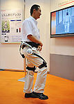 """Nobember 9, 2011, Tokyo, Japan - Honda Motor's  """"walk assist"""" device is being demonstrated during the International Robot Exhibition 2011 opened in Tokyo on Wednesday, November 9, 2011. The three-day trade show, sponsored by the Japan Robot Association, was designed promote new products and develop new business through contributing the promotion of new technology. (Photo by Natsuki Sakai/AFLO) [3615] -mis-.."""