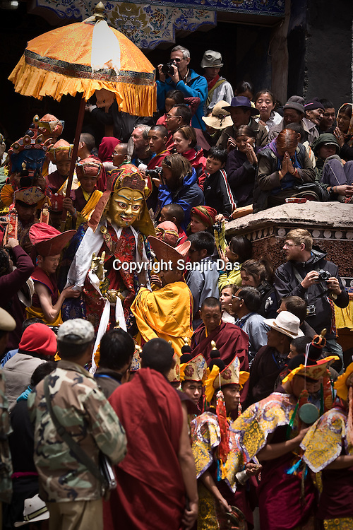 """Tourists gather to take photos of statues and dancers as they are brought out for a performance at the Hemis Monastery (gompa) of the Drukpa Lineage, located in Hemis, 45 kms away from Leh in Ladakh. ..His Holiness the Twelfth Gyalwang Drukpa, the head of the Drukpa Lineage (proponents of the Mahayana Buddhist tradition) ended his """"Walking On The World's Rooftop"""" Pad Yatra from Manali to Hemis Monestary in Ladakh."""