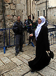A Palestinian woman walks past Israeli policemen as they stand guard in Jerusalem's old city following Friday prayers on November 6, 2015. The current wave of violence erupted in mid-September, fueled by rumors that Israel was trying to increase Jewish presence in Jerusalem then quickly spread across Israel, the West Bank and the Gaza Strip. Photo by Mahfouz Abu Turk