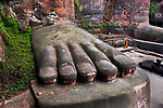 _DSC1341, Vacheron, China, 02/2016, CHINA-10360. A monk walks among the feet of a large Buddha statue.<br /> CHECK IMAGE USAGE<br /> <br /> Leshan Giant Buddha. China, 2016.<br /> <br /> FINAL_Vacheron<br /> <br /> Retouched_Sonny Fabbri 03/22/2016<br /> Cleaned up 5/14/18 Emily Rogers<br /> <br /> Bonnie Book<br /> FINAL SELECT