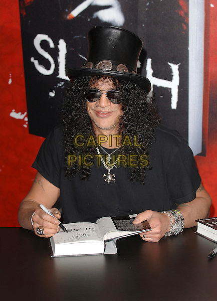 "SLASH - SAUL HUDSON .Slash of Guns N Roses, signs copies of his autobiography entitled ""Slash"" at Waterstones, Picadilly, London, England, 21st November 2007..Book Signing half length necklacee black hat sunglasses.CAP/ BEL.©Tom Belcher/Capital Pictures."