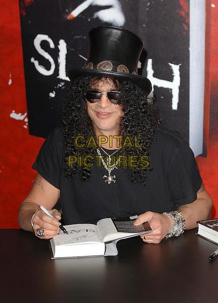 "SLASH - SAUL HUDSON .Slash of Guns N Roses, signs copies of his autobiography entitled ""Slash"" at Waterstones, Picadilly, London, England, 21st November 2007..Book Signing half length necklacee black hat sunglasses.CAP/ BEL.©Tom Belcher/Capital Pictures."