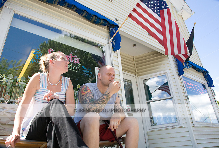Body piercer Sean Jeweii and apprentice piercer, Tracy Baker, in front of their body piercing/tattoo shop in Rockland, Maine.