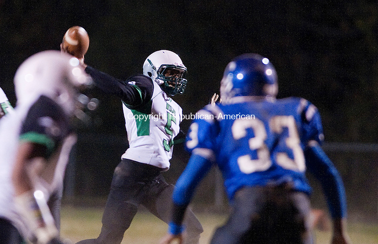 WATERBURY- 102513JS04-  Wilby's Darren Bell (5) throws a 22-yard touchdown pass Taifa Wright to during their game against Crosby Friday at Crosby High School.<br /> Jim Shannon Republican-American