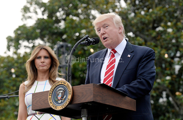 United States President Donald J. Trump speaks as First Lady Melania Trump looks on during the Congressional Picnic on the South Lawn  of the White House in Washington, DC, on June 22, 2017. <br /> Credit: Olivier Douliery - Pool via CNP /MediaPunch
