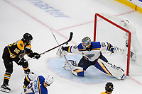 June 12, 2019: St. Louis Blues goaltender Jordan Binnington (50) stops a shot as Boston Bruins left wing Marcus Johansson (90) looks for the rebound during game 7 of the NHL Stanley Cup Finals between the St Louis Blues and the Boston Bruins held at TD Garden, in Boston, Mass.  The Saint Louis Blues defeat the Boston Bruins 4-1 in game 7 to win the 2019 Stanley Cup Championship.  Eric Canha/CSM.