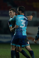 Matt Bloomfield and Joe Jacobson of Wycombe celebrate their side's win at full time of the Sky Bet League 2 match between Newport County and Wycombe Wanderers at Rodney Parade, Newport, Wales on 22 November 2016. Photo by Mark  Hawkins.