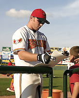 August 11, 2004:  Jason Kubel (18) of the Rochester Red Wings, Triple-A International League affiliate of the Minnesota Twins, signs autographs before a game at Frontier Field in Rochester, NY.  Photo by:  Mike Janes/Four Seam Images