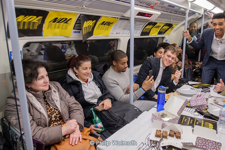 NDL impromptu restaurant on the Jubilee Line.  Tables set at Kilburn, pizzas arrive at Finchley Road, dessert at Waterloo.