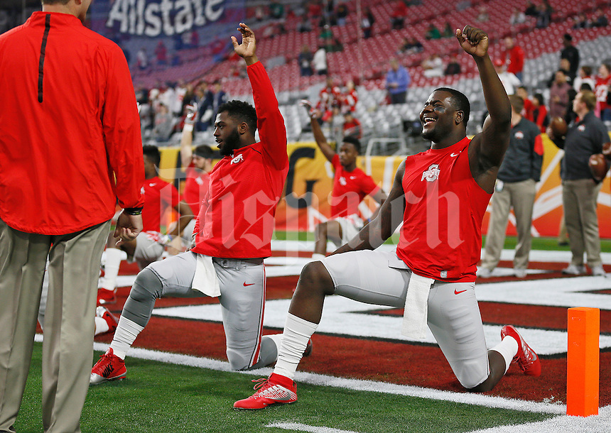 Ohio State Buckeyes quarterbacks, from right, Cardale Jones, and J.T. Barrett stretch prior to the Battlefrog Fiesta Bowl against the Notre Dame Fighting Irish at University of Phoenix Stadium in Glendale, Arizona on Jan. 1, 2016. (Adam Cairns / The Columbus Dispatch)