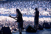 Pantera - guitarist Dimebag Darrell Abbott and vocalist Phil Anselmo - performing live on the Main Stage at the 1997 Ozzfest held at Gians Stadium in East Rutheford NJ USA - Jun 15,1997.  Photo credit: Eddie Malluk/IconicPix