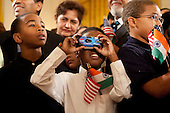 Washington, DC - November 24, 2009 -- Omar Carrington takes a photograph of the East Room in the White House before a ceremony with U.S. President Barack Obama and Manmohan Singh, India's prime minister, in Washington, D.C., U.S., on Tuesday, Nov. 24, 2009. Singh was welcomed to the White House this morning by Obama for a state visit where the two leaders will have discussions on curbing nuclear weapons, climate change and trade. .Credit: Andrew Harrer - Pool via CNP