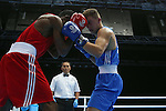 Glasgow 2014 Commonwealth Games<br /> Men's Light Welter (64kg)<br /> Zack Davies, Wales (Blue) v Waheed Shogbamu, Nigeria (Red)<br /> 27.07.14<br /> &copy;Steve Pope-SPORTINGWALES