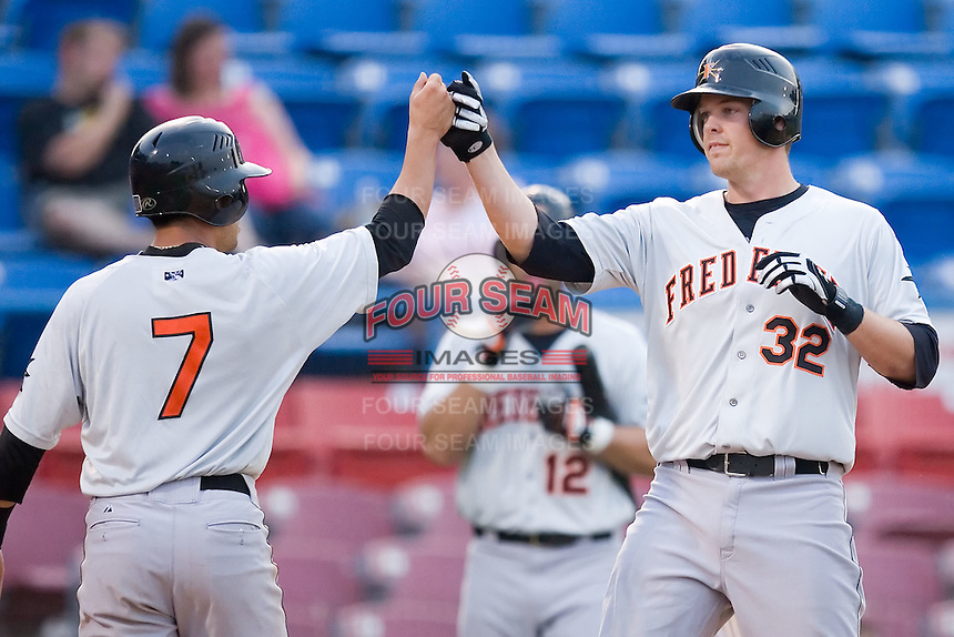Matt Wieters (32) of the Frederick Keys is greeted at home plate by teammate Todd Davison (7) following his 3-run home run in the 5th inning versus the Winston-Salem Warthogs at Ernie Shore Field in Winston-Salem, NC, Saturday, June 7, 2008.