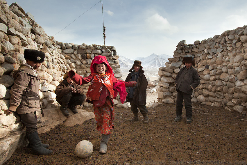 Kids are happy with the only football in the Afghan Pamir, brought by an anthropologist in 2010...At the Qyzyl Qorum camp. It is the camp of the now deceased Khan (Abdul Rashid Khan, died in December 2009), and headed by the self proclaimed young Haji Roshan Khan (his son). Opium addicted Haji Roshan was never officially stated Khan and is therefore not accepted as leader by the entire Kyrgyz community. Near the Afghan-China border...Trekking through the high altitude plateau of the Little Pamir mountains, where the Afghan Kyrgyz community live all year, on the borders of China, Tajikistan and Pakistan.